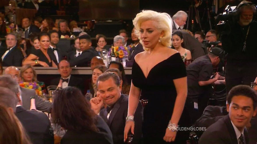 10 January 2016 - Los Angeles - USA **** STRICTLY NOT AVAILABLE FOR USA *** Leonardo DiCaprio pulls a funny face as Lady Gaga brushes past him to collect her Golden Globe Award. The best reaction to Lady Gaga's win at the awards ceremony in Los Angeles came before the singer turned actress had even reached the stage. The cameras at LA's Beverly Hilton caught a classic candid moment as the 29 year-old made her way through the crowd following the surprise announcement of her name from the Best Supporting Actress nominees. The songstress seemed to be in a bit of a daze as she squeezed between the seats - and didn't even notice when she ploughed her way past DiCaprio's protruding elbow, which was sticking out in her path. The Revenant star was sharing a laugh with someone at his table with his arm on the back of her chair, oblivious the platinum blonde was on a collision course behind him. While Gaga didn't even flinch, her fellow nominee appeared to be freaked out when he looked up the see it was the Countess who had barged into him - and it was all caught on camera. After rolling his eyes, DiCaprio- who was also Golden Globe winner, put his arm back on his seat, while Gaga made her way to the stage. XPOSURE PHOTOS DOES NOT CLAIM ANY COPYRIGHT OR LICENSE IN THE ATTACHED MATERIAL. ANY DOWNLOADING FEES CHARGED BY XPOSURE ARE FOR XPOSURE'S SERVICES ONLY, AND DO NOT, NOR ARE THEY INTENDED TO, CONVEY TO THE USER ANY COPYRIGHT OR LICENSE IN THE MATERIAL. BY PUBLISHING THIS MATERIAL , THE USER EXPRESSLY AGREES TO INDEMNIFY AND TO HOLD XPOSURE HARMLESS FROM ANY CLAIMS, DEMANDS, OR CAUSES OF ACTION ARISING OUT OF OR CONNECTED IN ANY WAY WITH USER'S PUBLICATION OF THE MATERIAL. BYLINE MUST READ : NBC/XPOSUREPHOTOS.COM PLEASE CREDIT AS PER BYLINE *UK CLIENTS MUST CALL PRIOR TO TV OR ONLINE USAGE PLEASE TELEPHONE 44 208 344 2007