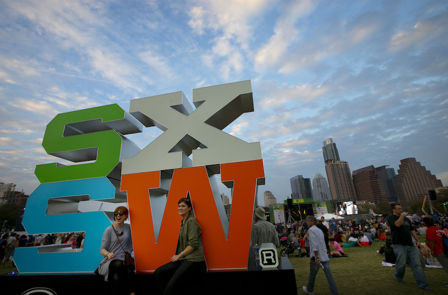 Laura Mac Darby, left, and Emer Ryam, both from Dublin, Ireland, attend the free concert at Auditorium Shores headlined by Spoon at SXSW on Thursday, March 19, 2015. (AP Photo/Austin American-Statesman, Jay Janner)